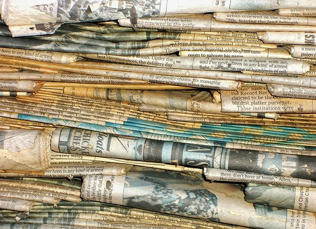 weathered stack of newspapers