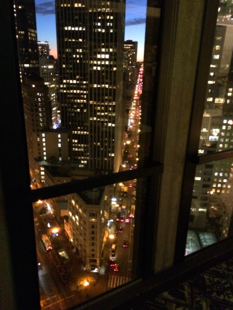 City lights through the window. The twenty-seventh floor is wayyy high up.