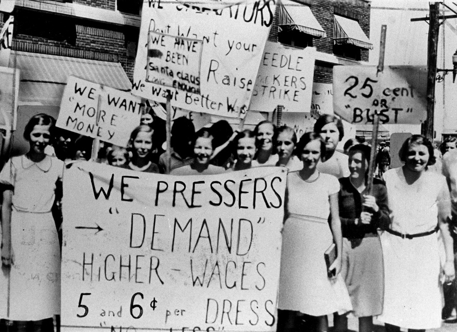 """Women pressers on strike for higher wages. Best sign: """"We have been Santa Claus long enough."""" Photo via the Kheel Center."""