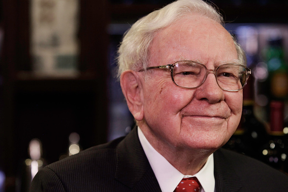Warren Buffet, chairman and CEO of Berkshire Hathaway, looking pleased. Photo via Getty Images.