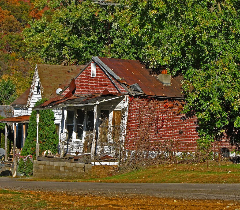 "Photo by Don O'Brien — a collapsing house ""[s]een during a visit to a small town along the Ohio Rver."""
